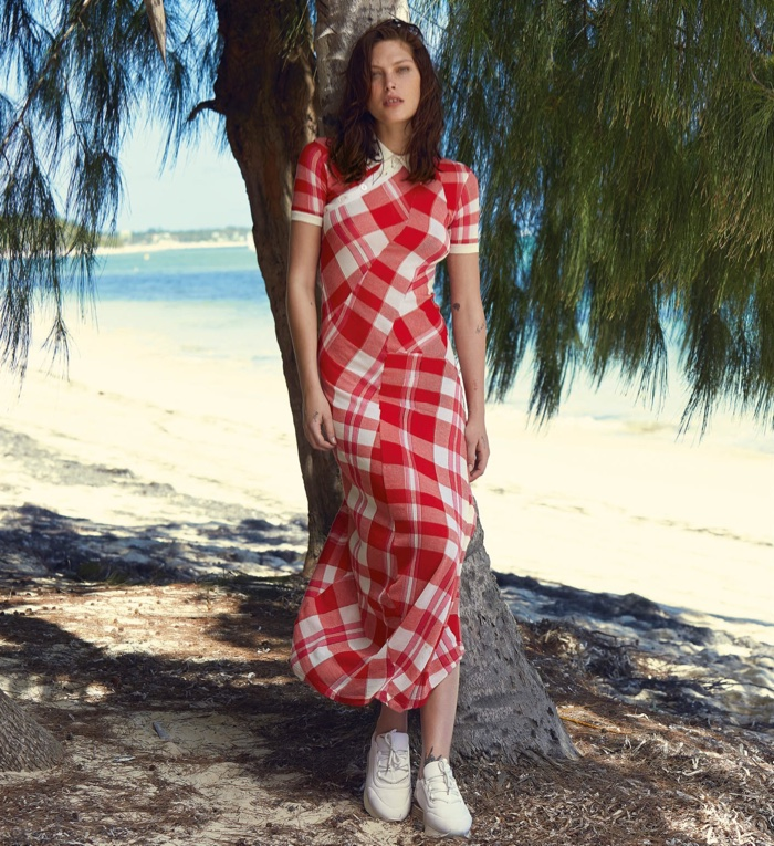 Catherine McNeil wears Stella McCartney printed dress with white sneakers