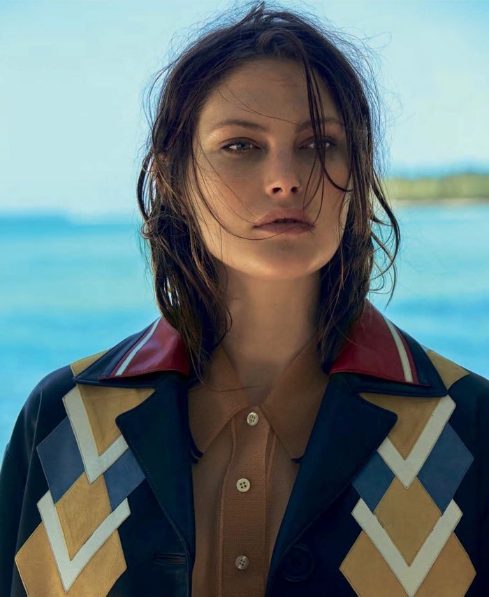The brunette model wears a Miu Miu jacket and shirt