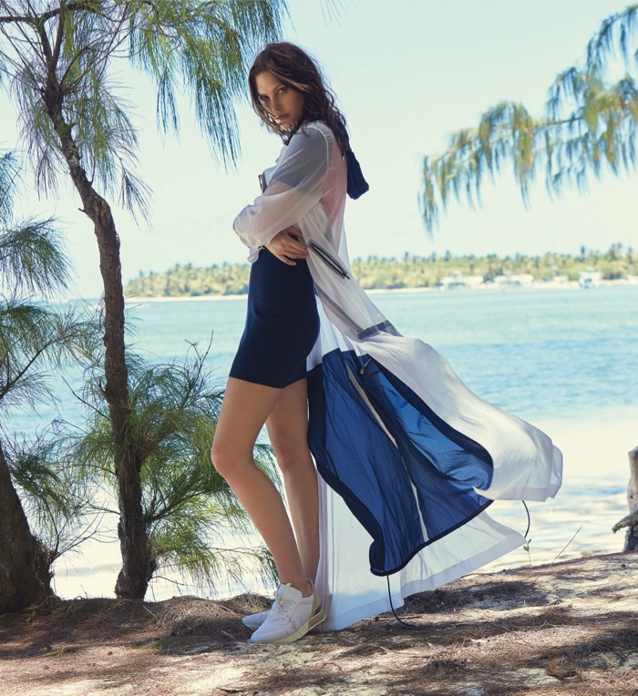 Catherine McNeil wears Lacoste jacket and dress