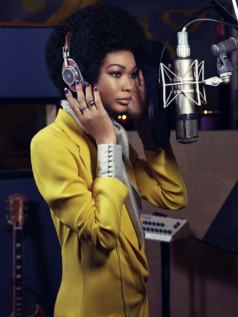 Posing in a recording studio, Chanel Iman wears an afro hairstyle