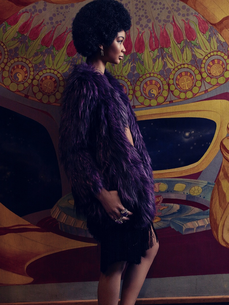 Chanel Iman models a shaggy purple fur coat