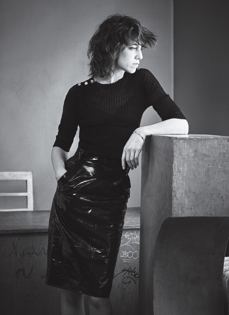 Charlotte Gainsbourg poses in knit sweater with high-waisted skirt