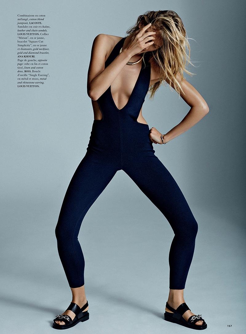 Constance Jablonski wears Lacoste jumpsuit with plunging neckline
