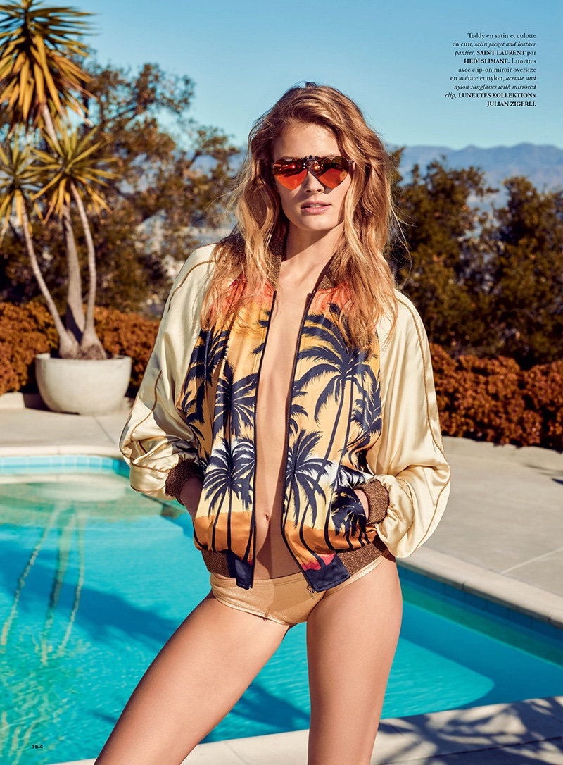 Constance Jablonski poses in Saint Laurent bomber jacket and bikini bottoms with heart-shaped sunglasses
