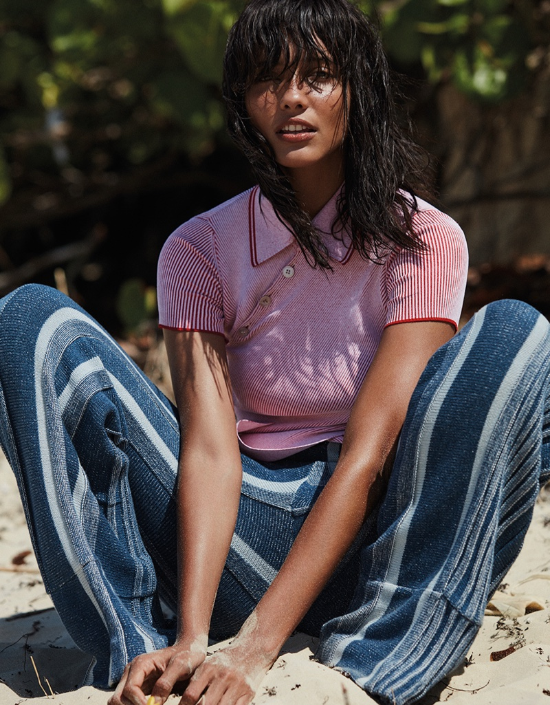 Cora Emmanuel poses in pink Stella McCartney top with striped pants