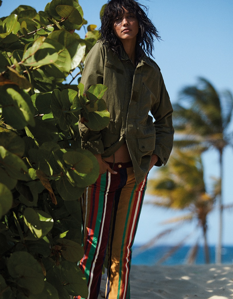 Cora Emmanuel wears khaki jacket with striped Tommy Hilfiger pants