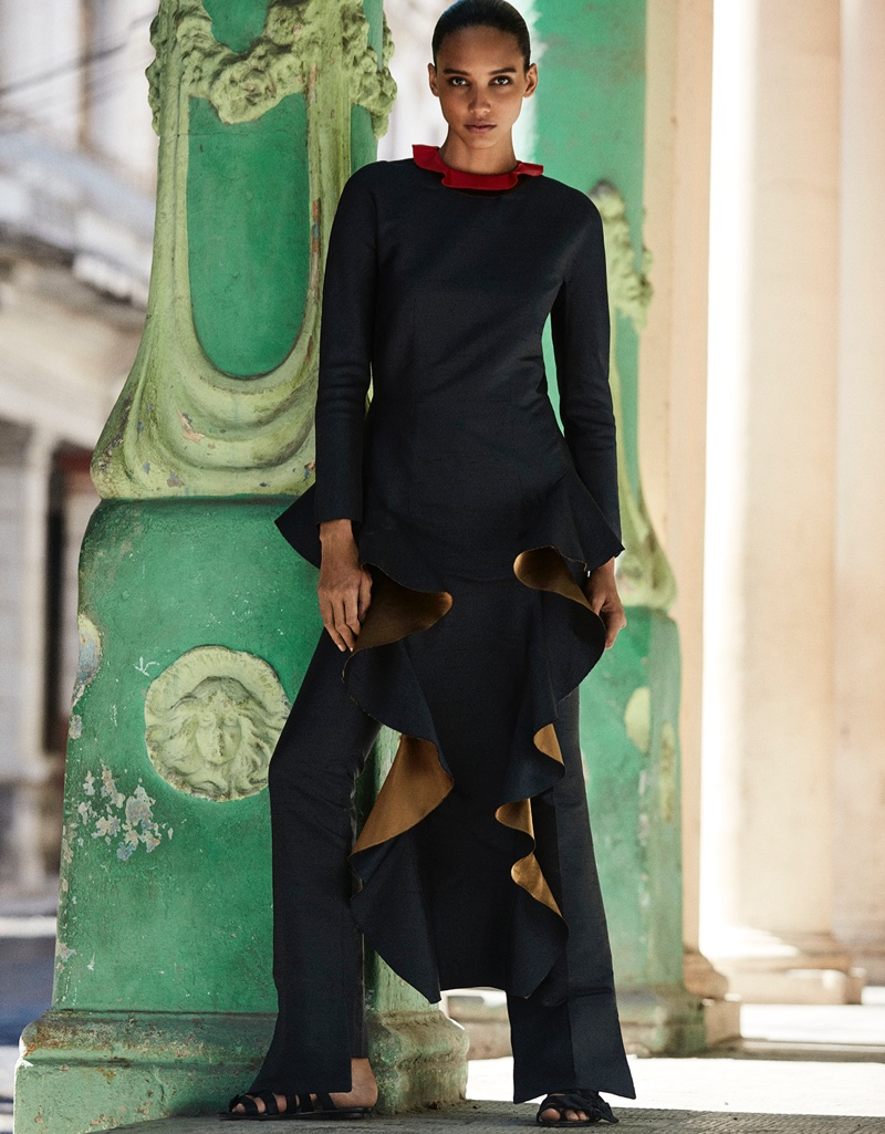 Cora Emmanuel wears a ruffle embellished top over trousers