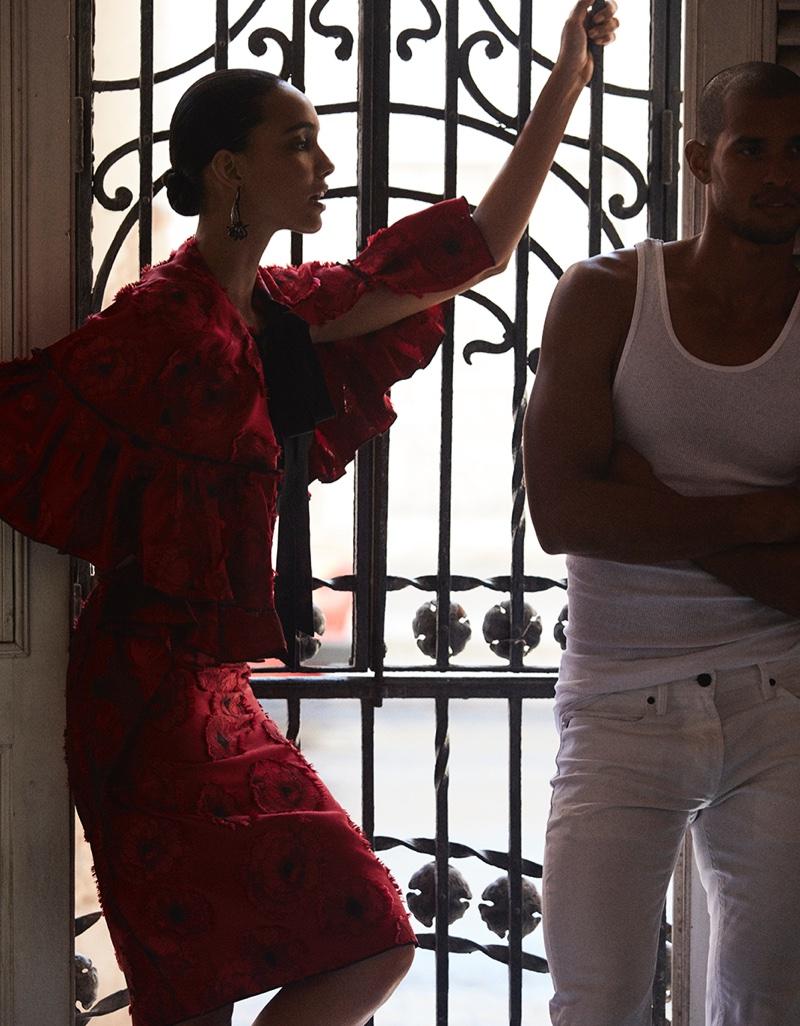 Cora Emmanuel looks red-hot in Oscar de la Renta red cape and skirt