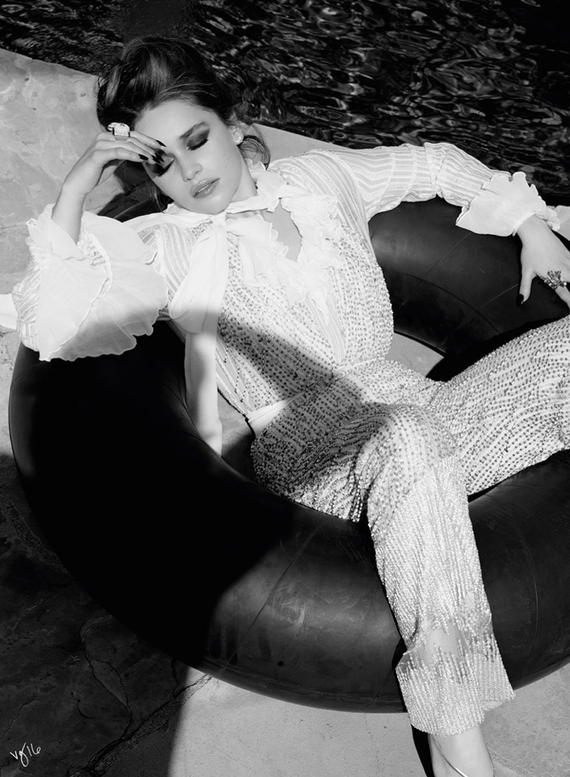 Photographed in black and white, Emilia Clarke wears Rodarte blouse and pants