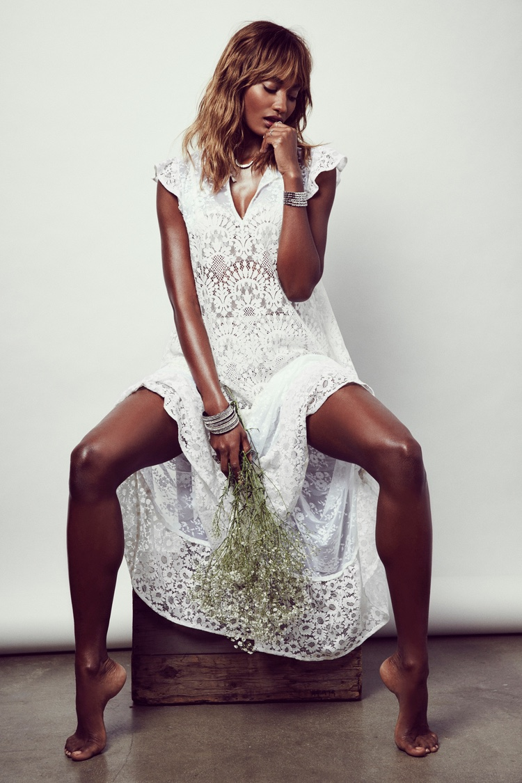 The model poses in For Love & Lemons' summer 2016 capsule collection of dresses