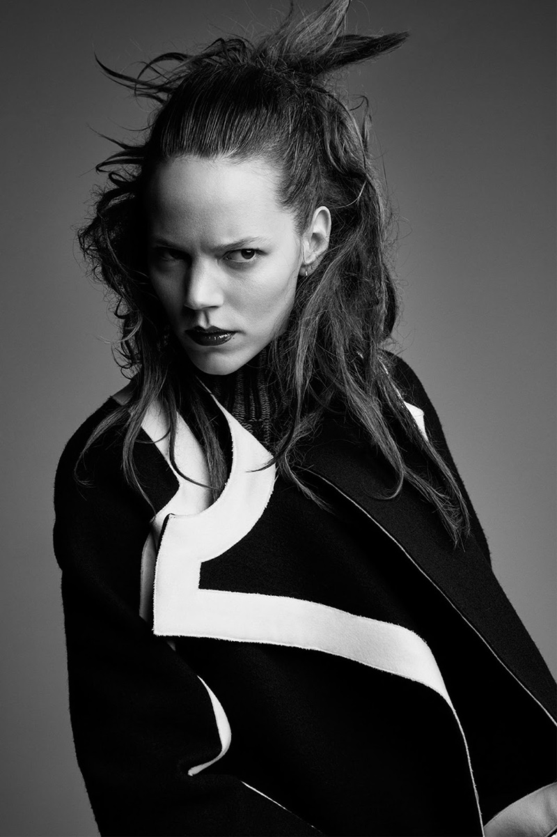 Freja Beha Erichsen wears black wool coat with white trim from Sportmax