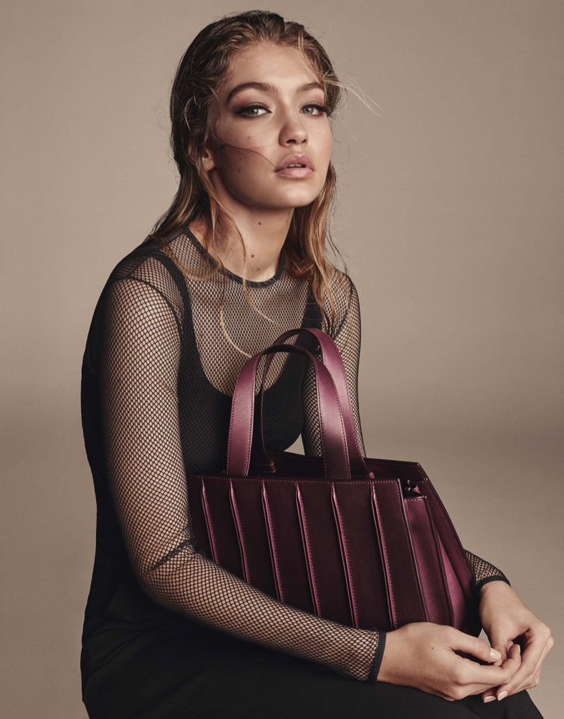 Gigi Hadid poses with the Max Mara Whitney Bag