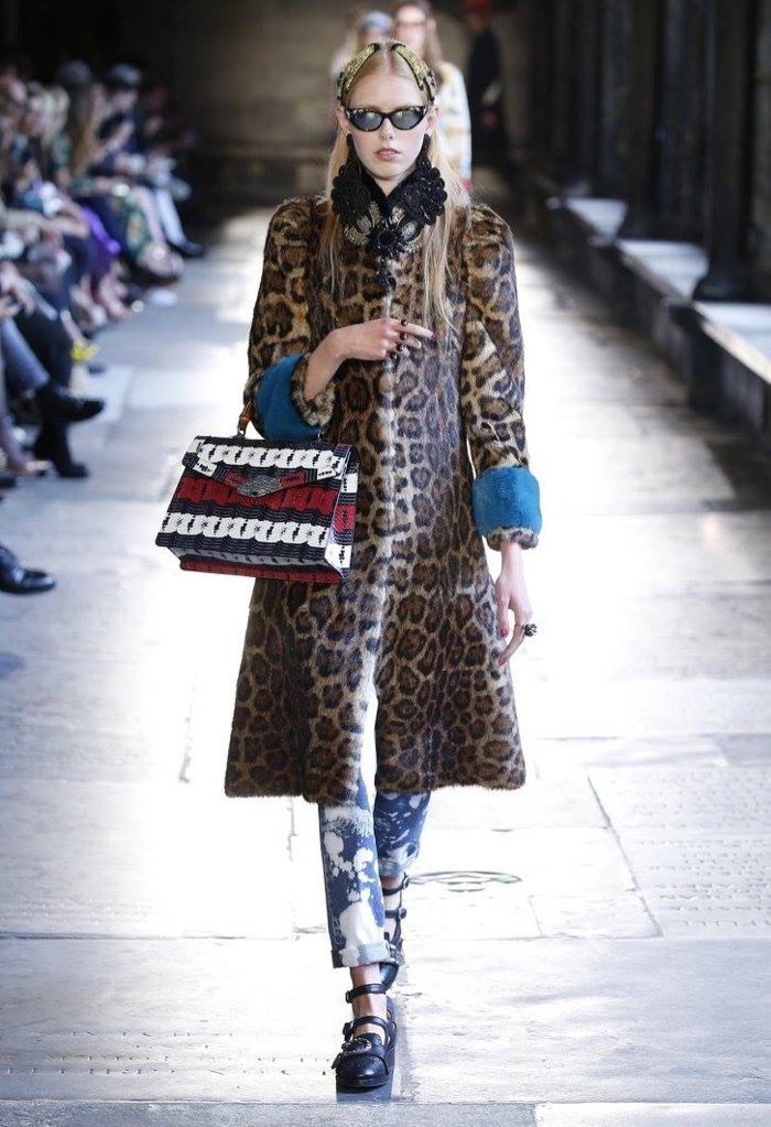 31440898827 A model walks the runway at Gucci s resort 2017 show wearing a leopard  print fur coat
