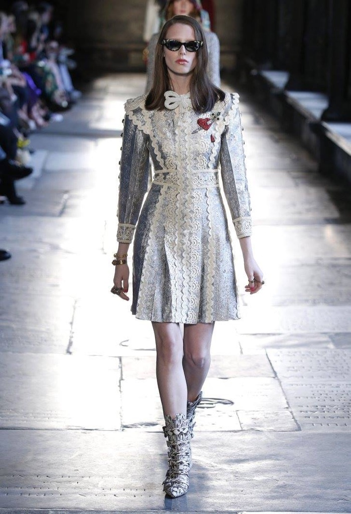 e8efbe94391 A model walks the runway at Gucci s resort 2017 show wearing a  lace-embellished dress