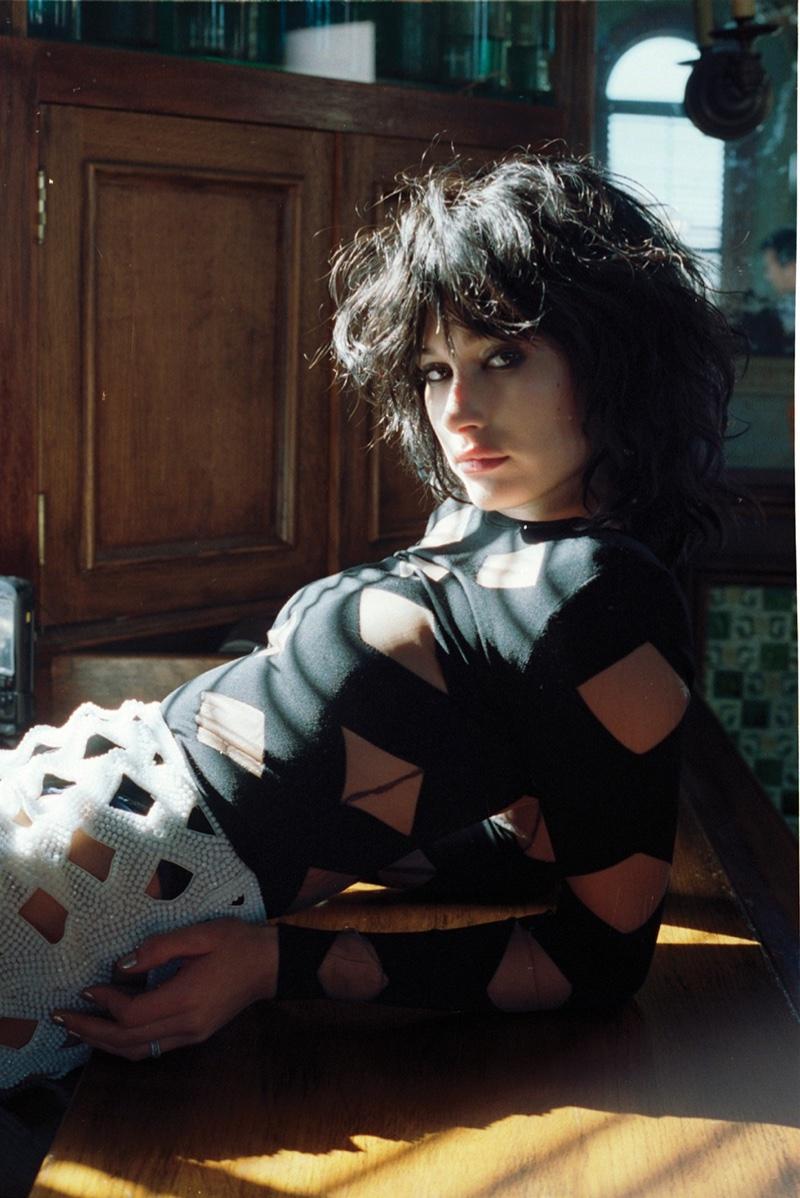 Hailey Baldwin wears a brunette wig in the fashion editorial