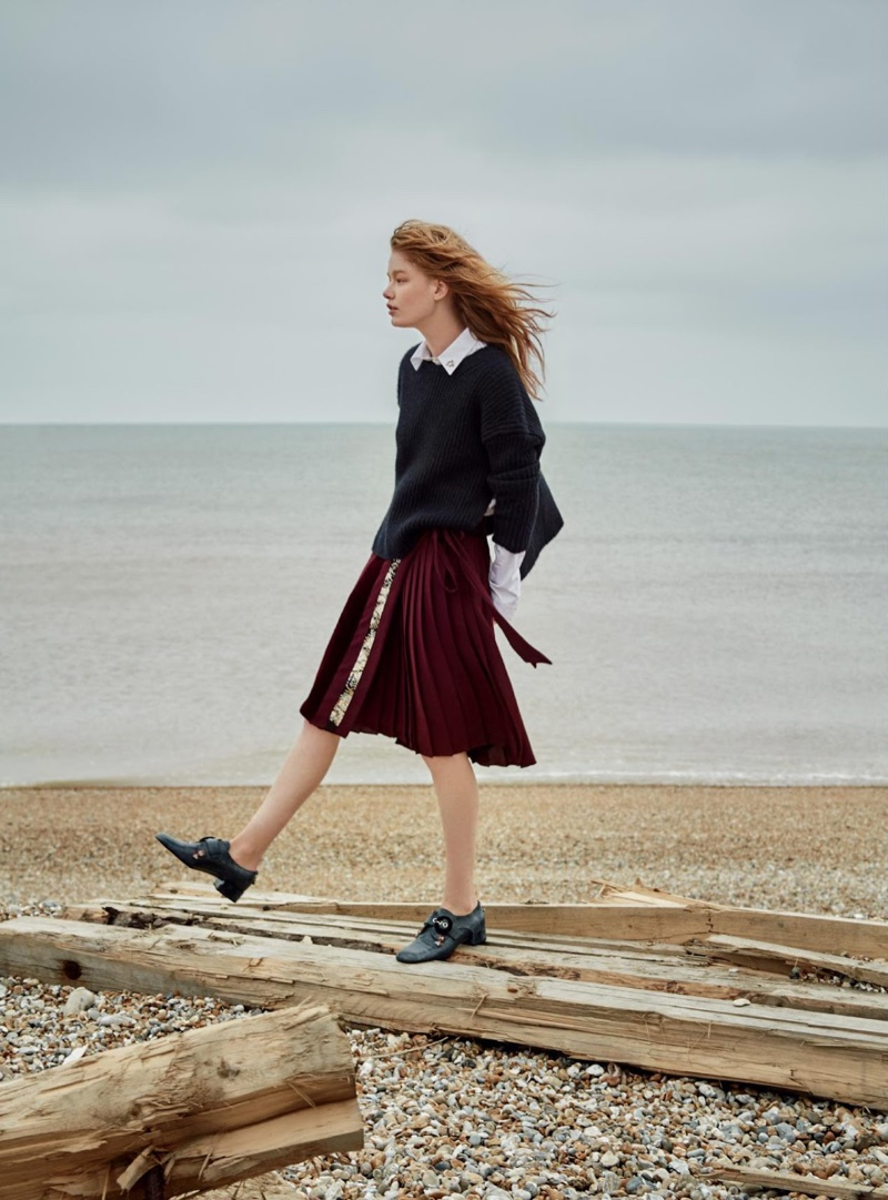 Walking the beach, Hollie-May models shirt, cashmere sweater, skirt and shoes from Dior