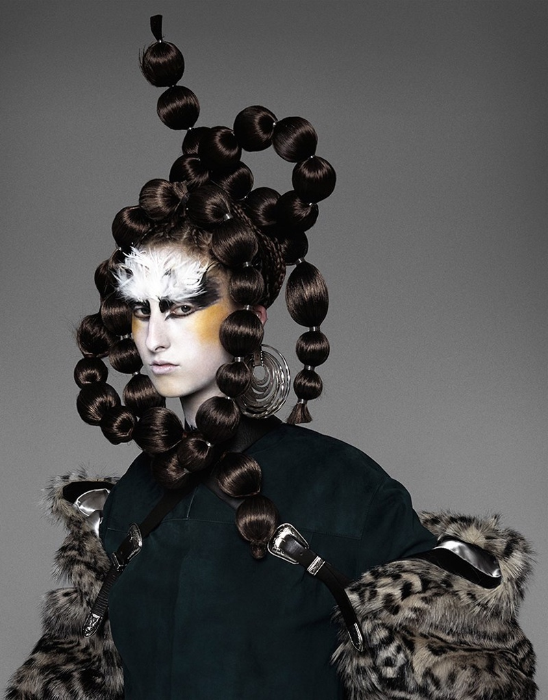 A painted face and hairstyle featuring bold twists appears in the editorial