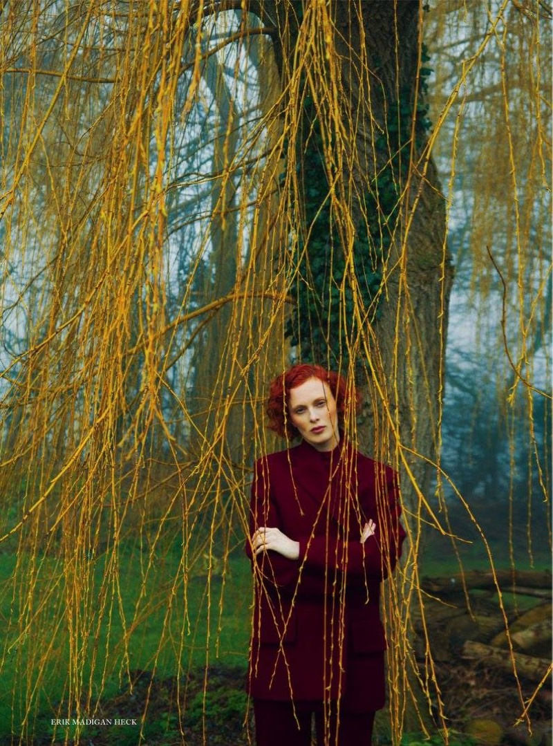 Leaning against a tree, Karen poses in Celine wool jacket, sweater and pants