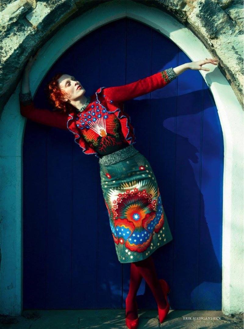 The model wears Valentino sweater and skirt with velvet heels from Rupert Sanderson