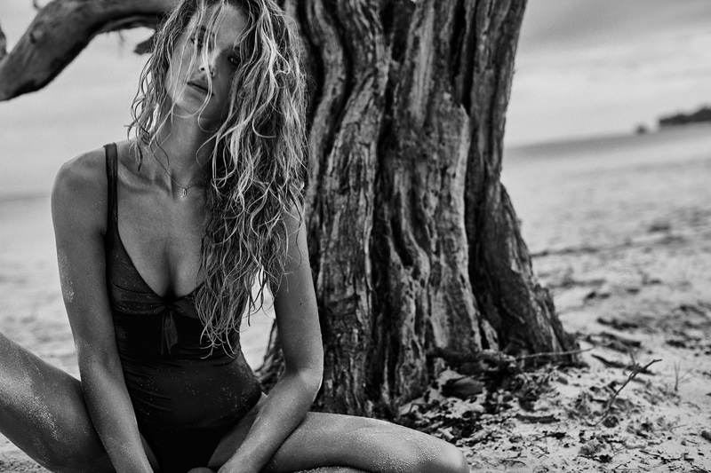 Photographed in black and white, Kate Bock poses in swimsuit