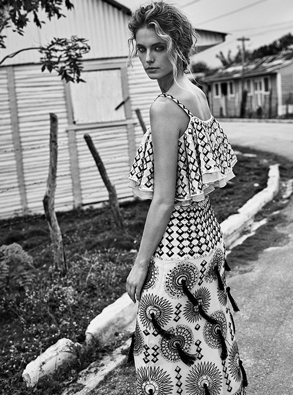 Photographed in black and white, Kate Bock wears ruffle top and tassel embellished skirt from Temperley London