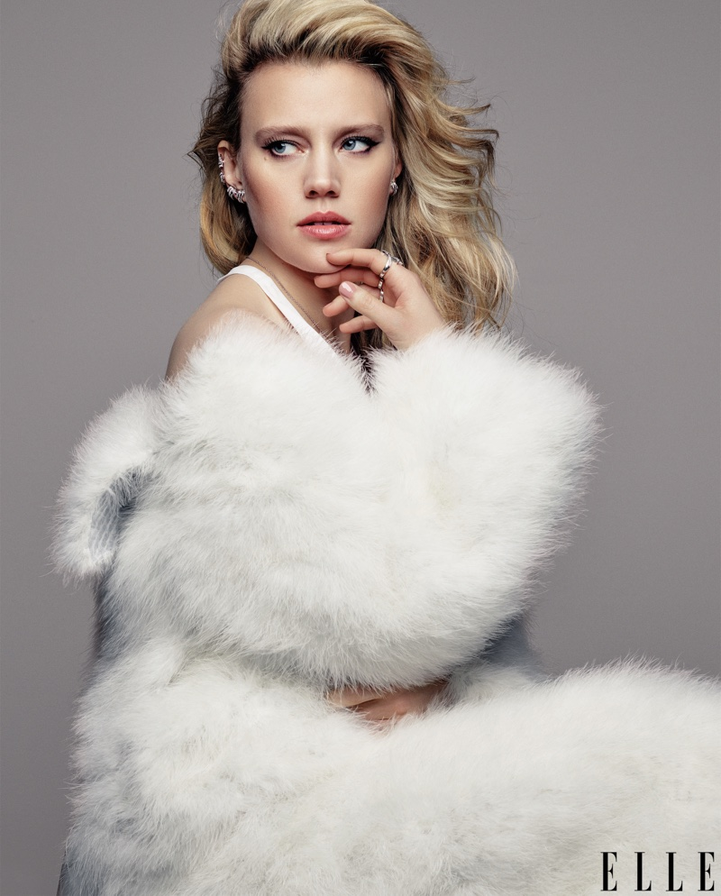Kate McKinnon wears Calvin Klein Collection coat with Chanel Fine Jewelry earrings