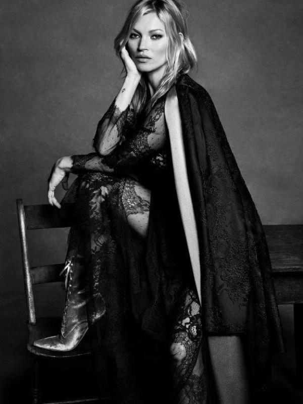 Photographed in black and white, Kate Moss wears a dramatic cape look for Alberta Ferretti's fall-winter 2016 campaign