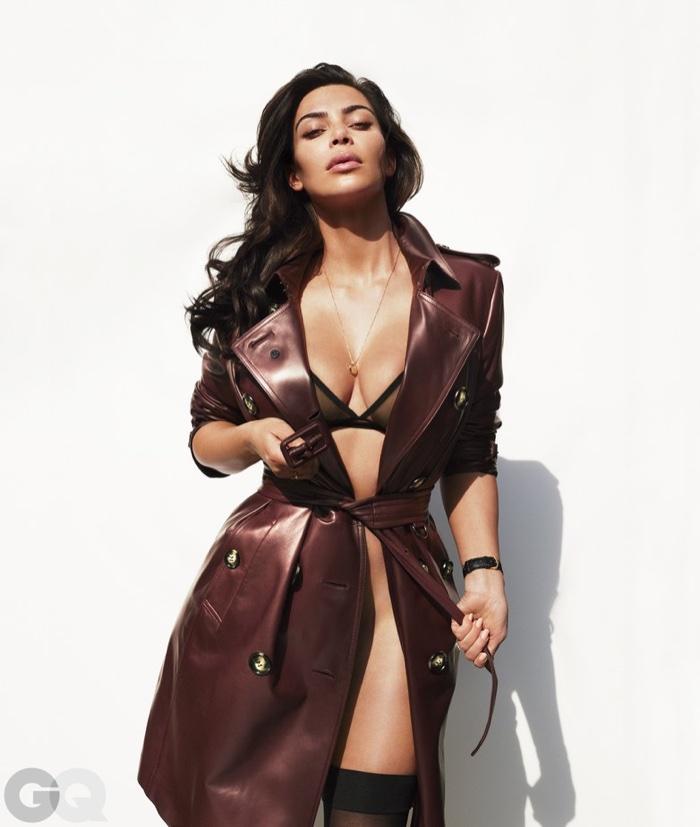 Kim Kardashian poses in Burberry trench coat with Eres bra