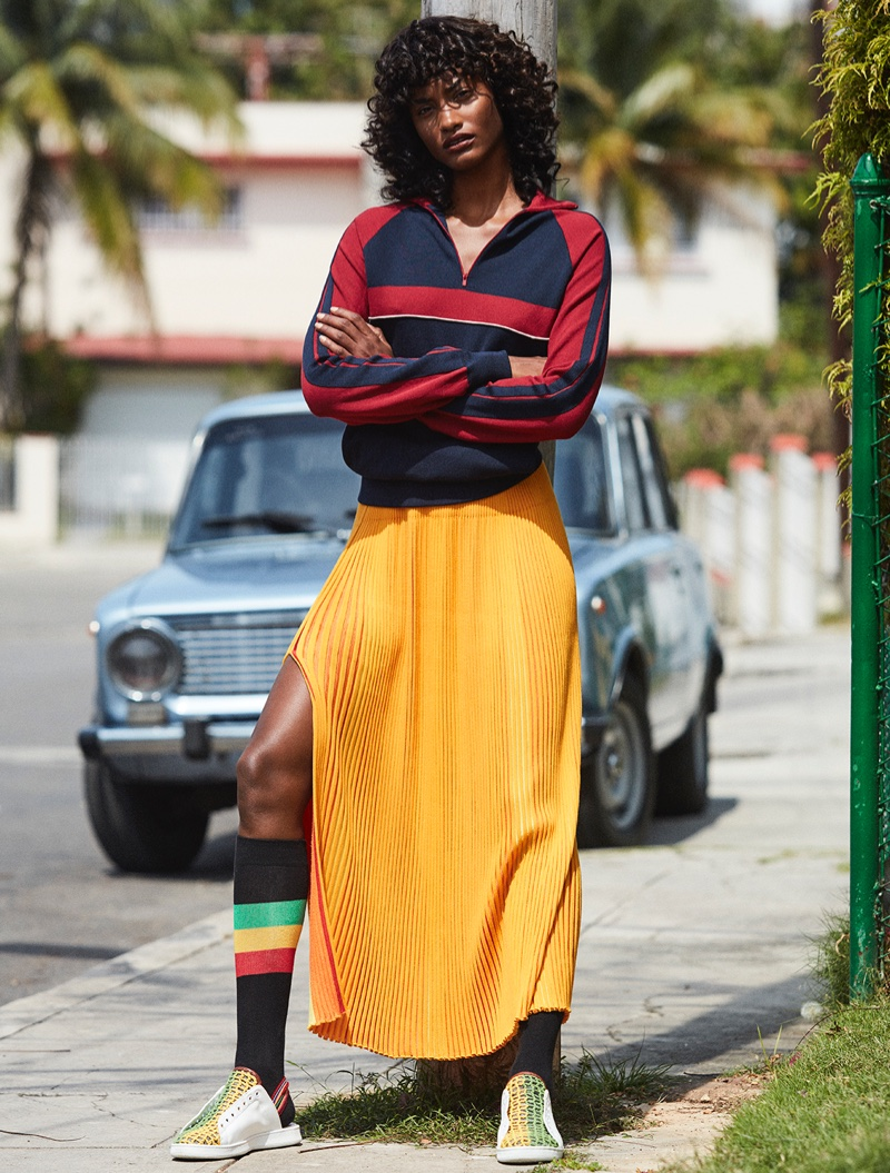 Melodie Monrose wears Chloe track jacket with pleated skirt