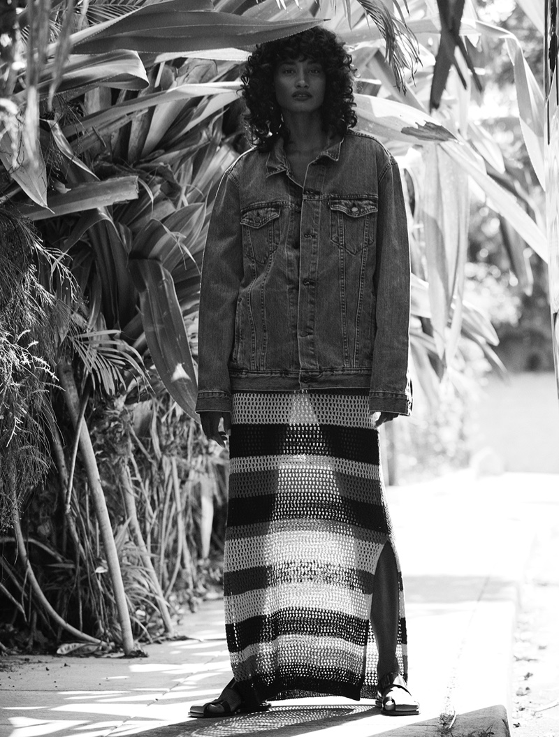 Melodie Monrose wears denim jacket and striped maxi skirt