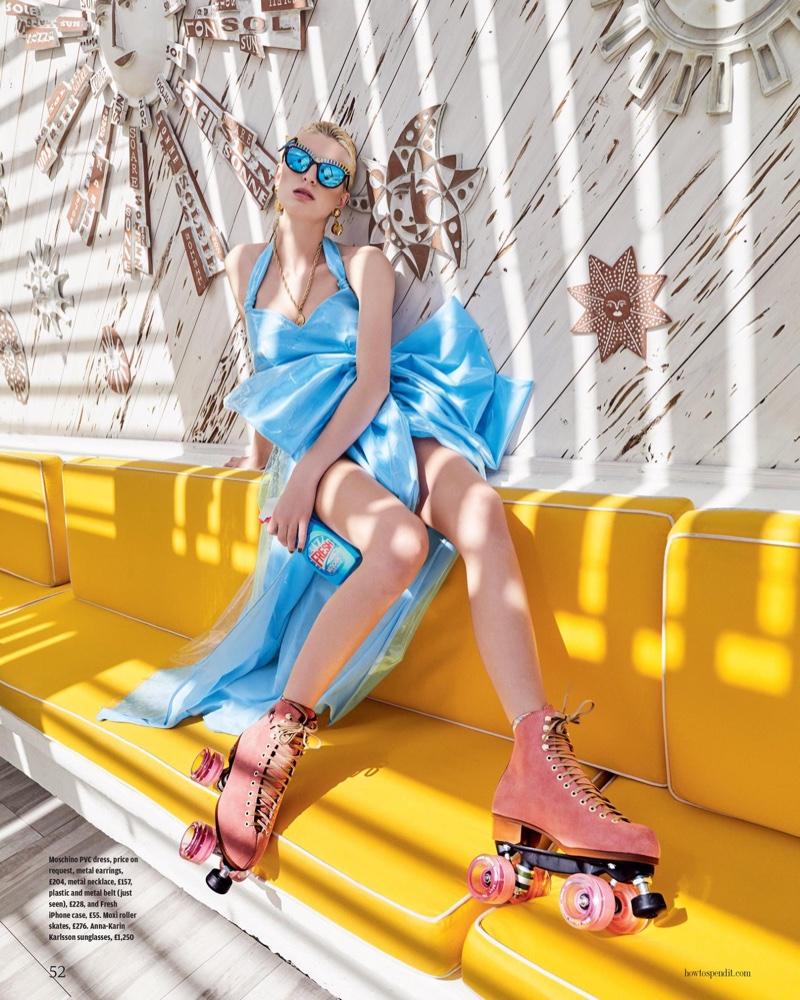 Rose Smith wears Moschino PVC dress with Anna-Karin Karlsson sunglasses and pink roller skates