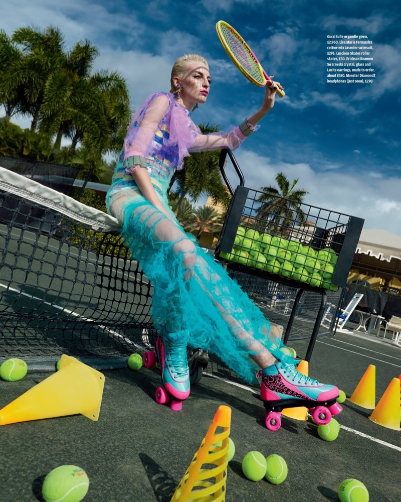 Hitting the tennis court, the blonde model wears Gucci tulle organdie gown with Lisa Marie Fernandez swimsuit