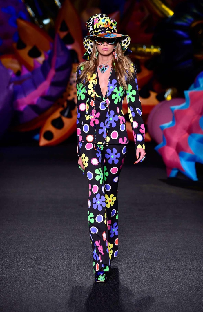 Moschino Resort 2017: Stella Maxwell walks the runway wearing an oversized hat and printed pantsuit