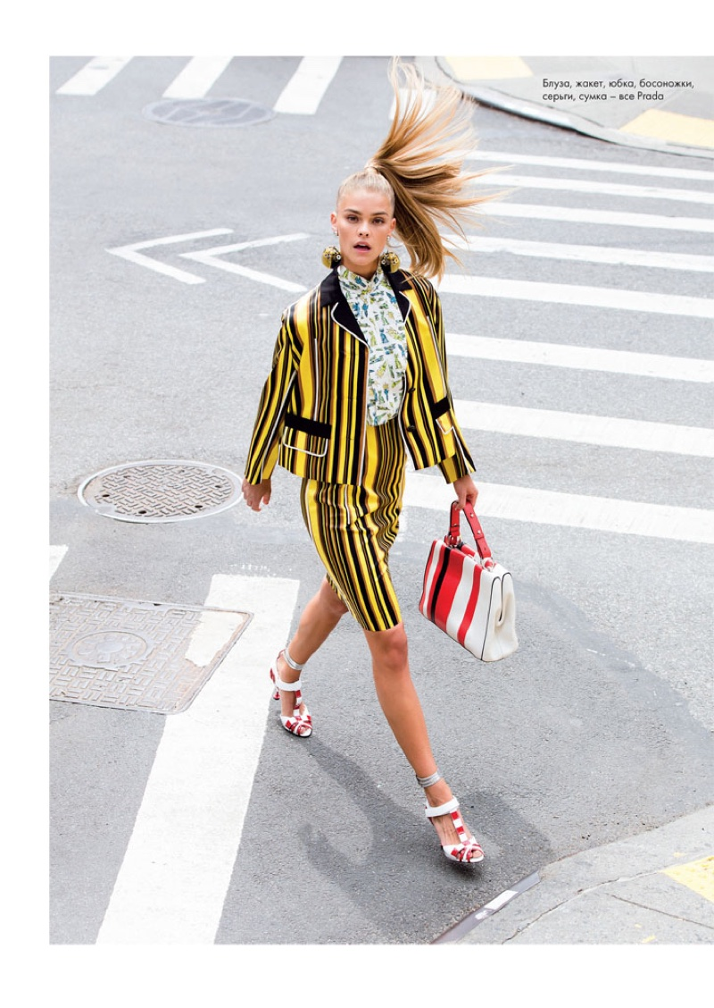 The blonde model hits the streets in striped jacket and skirt from Prada