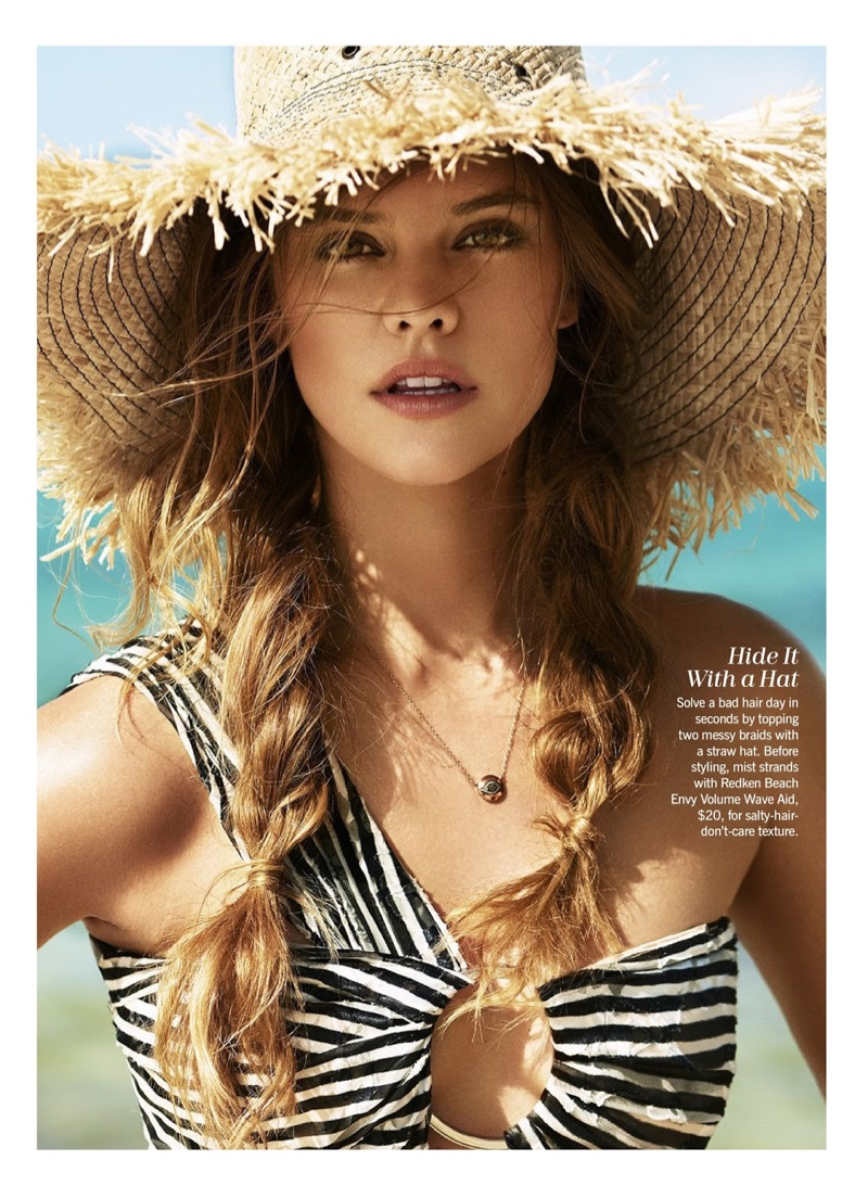 Soaking up the sun, Nina Agdal models Preen by Thornton Bregazzi swimsuit and straw hat
