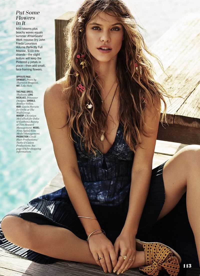 Nina Agdal looks bohemian chic in a Thakoon dress with blooms in her wavy hairstyle