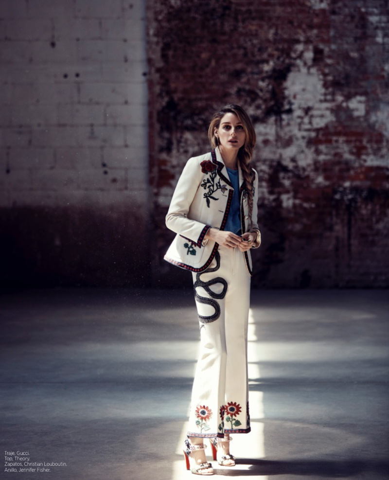 Olivia Palermo suits up in a white Gucci pantsuit