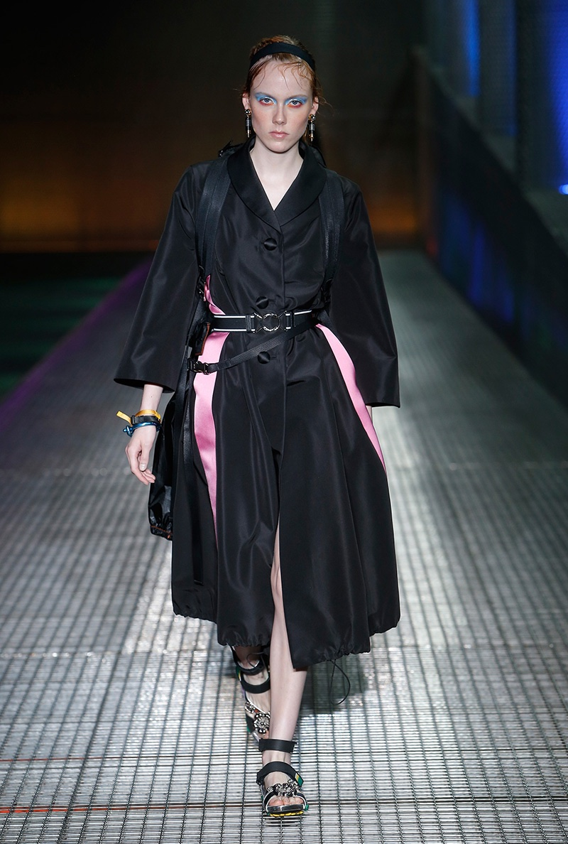 Prada resort 2017: A black wrap dress with kimono style sleeves appears on the runway