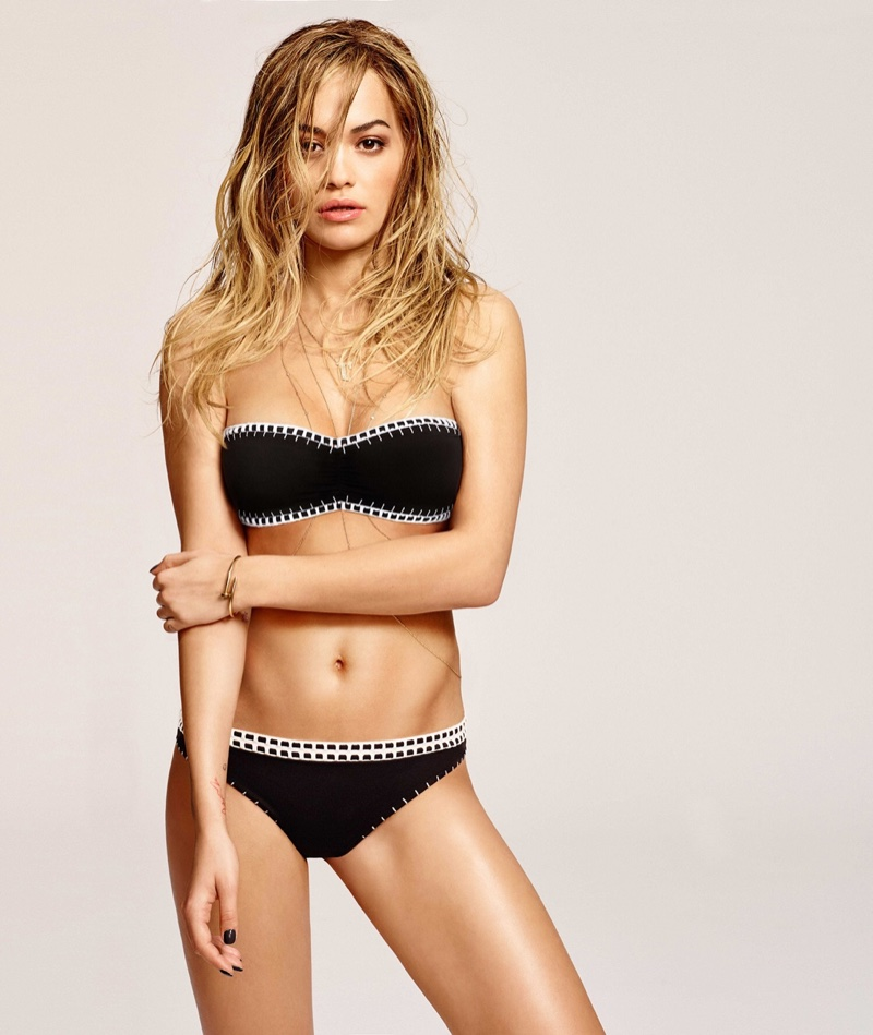 Rita Ora shows off her bikini body in a Tezenis black swim top and bottoms