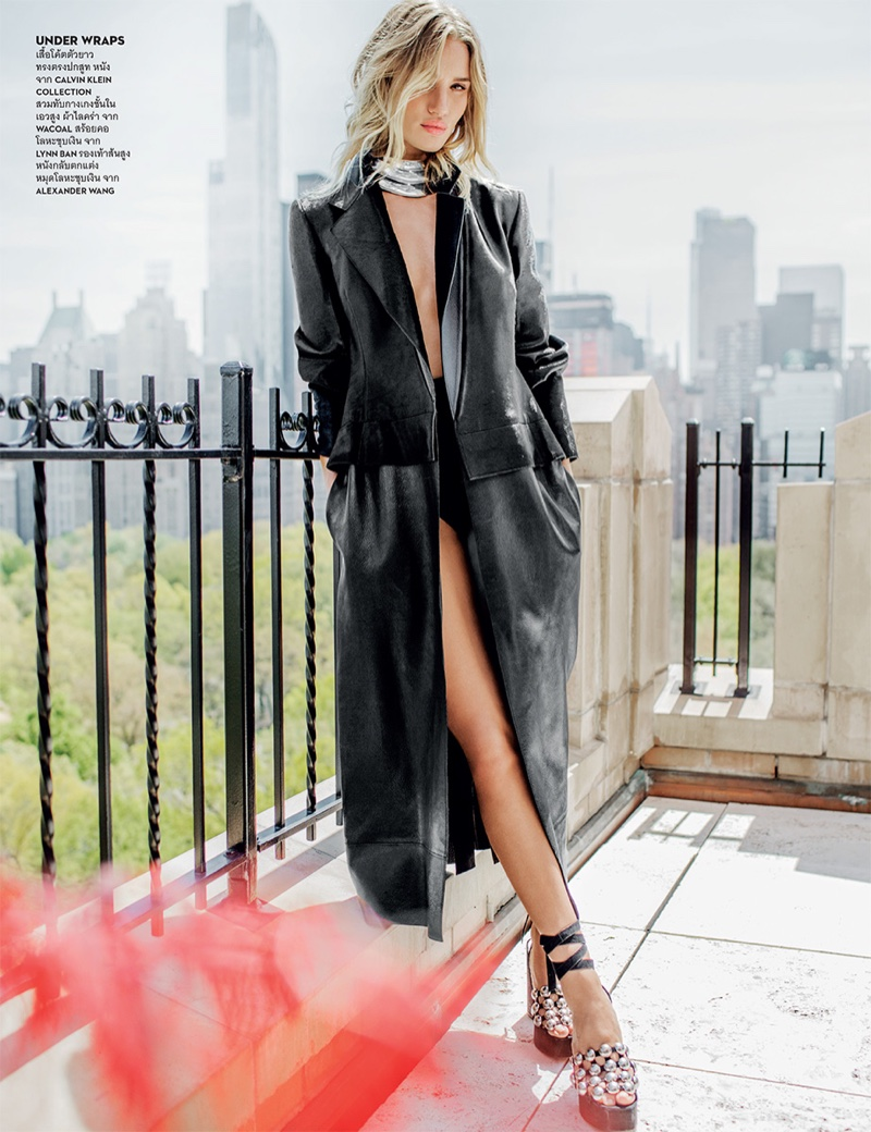 Rosie Huntington-Whiteley flaunts her legs in a Calvin Klein collection coat with Alexander Wang platform sandals