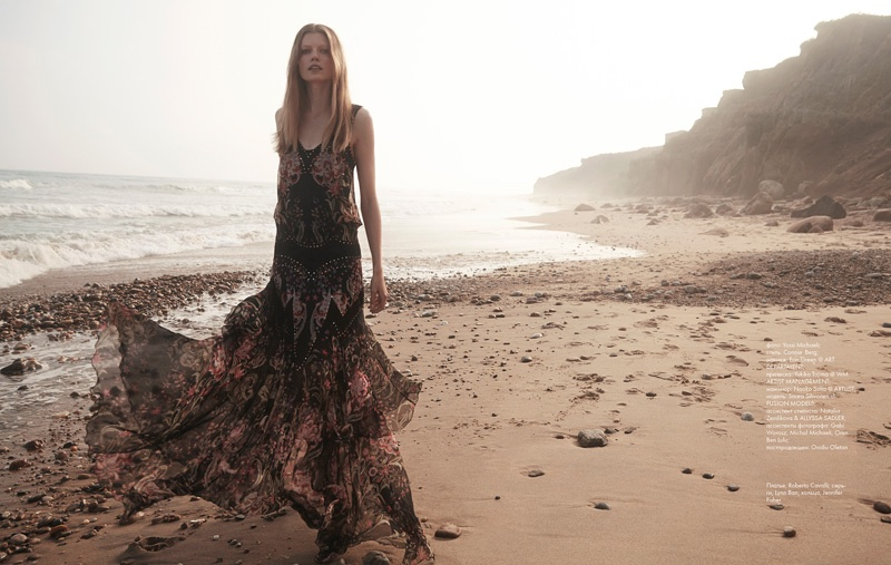 The blonde model wears a Roberto Cavalli gown
