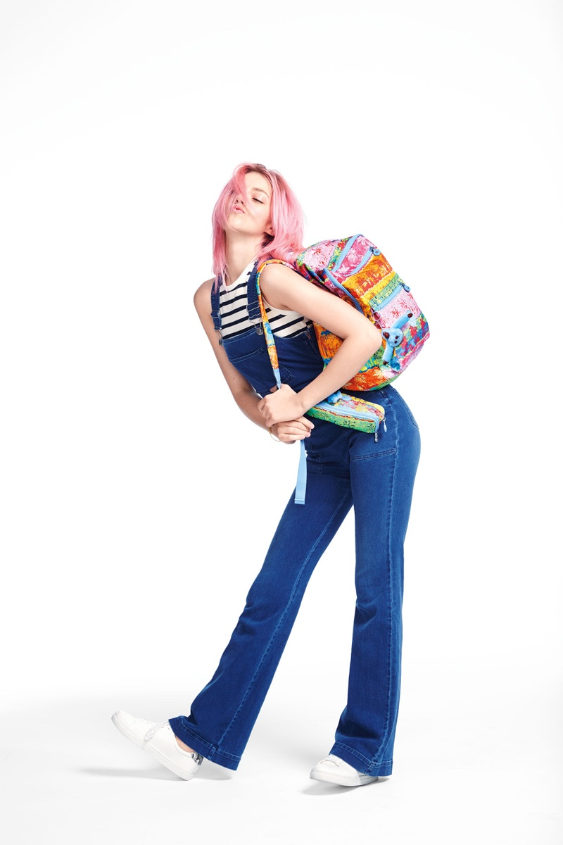 Pyper America Smith rocks overalls with a colorful backpack