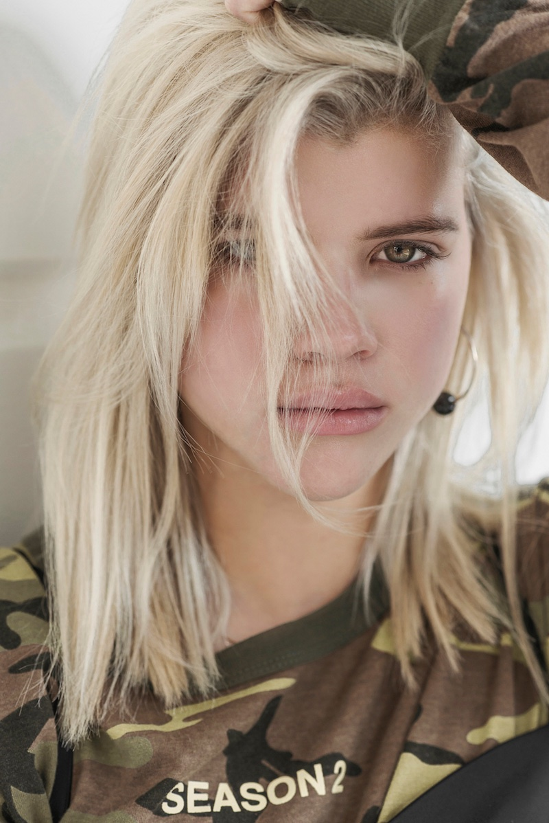 Sofia Richie poses with tousled hairstyle