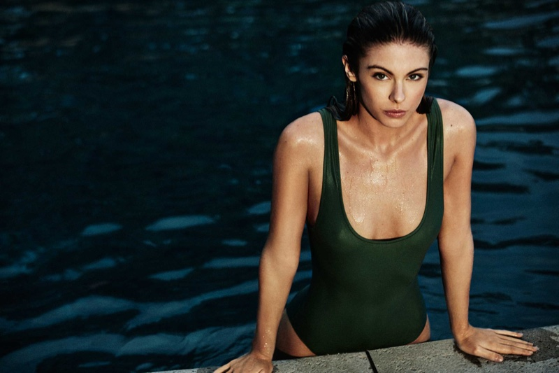 The blonde model takes a dip in the pool wearing Solid & Striped's Anne-Marie one-piece swimsuit in olive