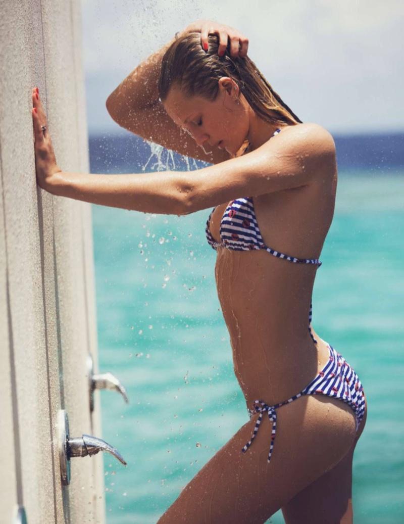 Toni Garrn soaks up the sun in striped bikini top and bottoms from Princesse Tam Tam