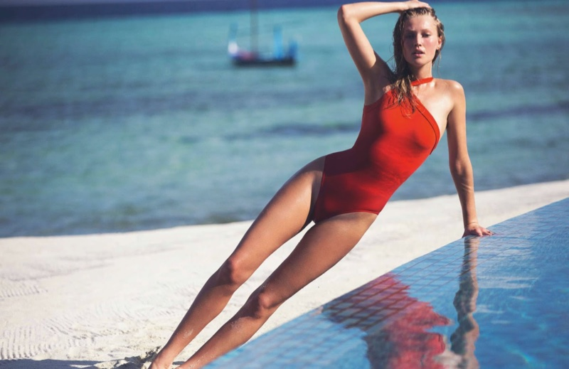 Toni Garrn flaunts her toned figure in a red Hermes one-shoulder swimsuit