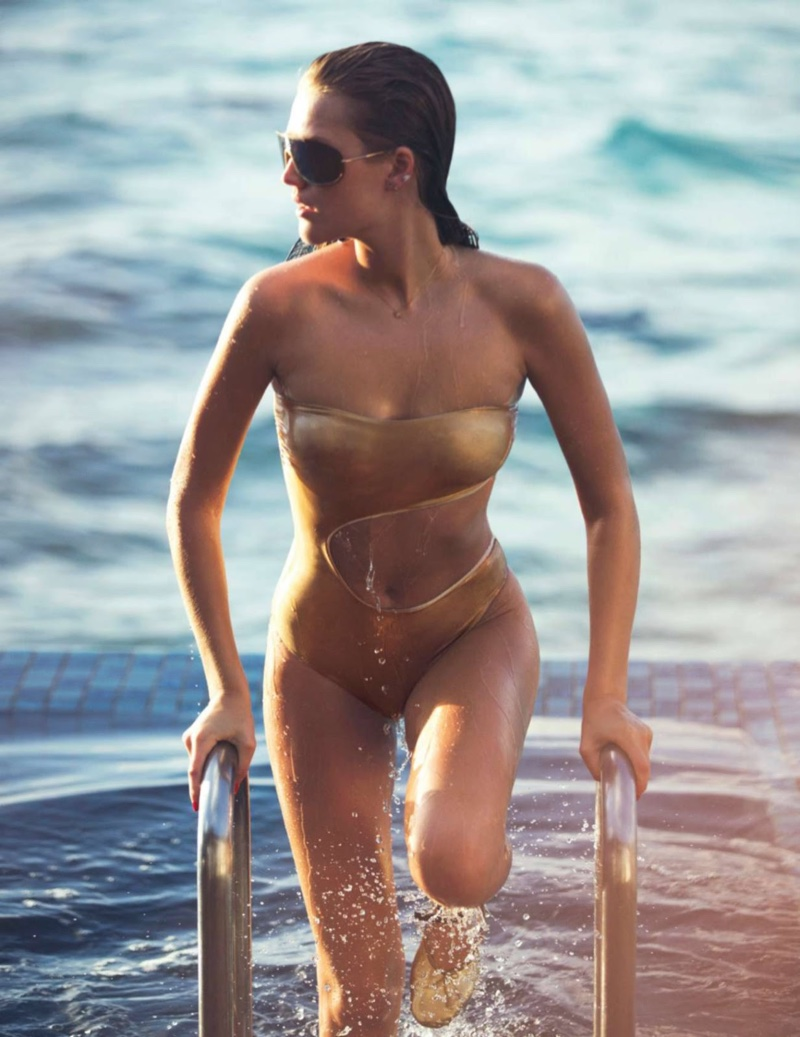 Toni Garrn shines like gold in Carioca one-piece swimsuit