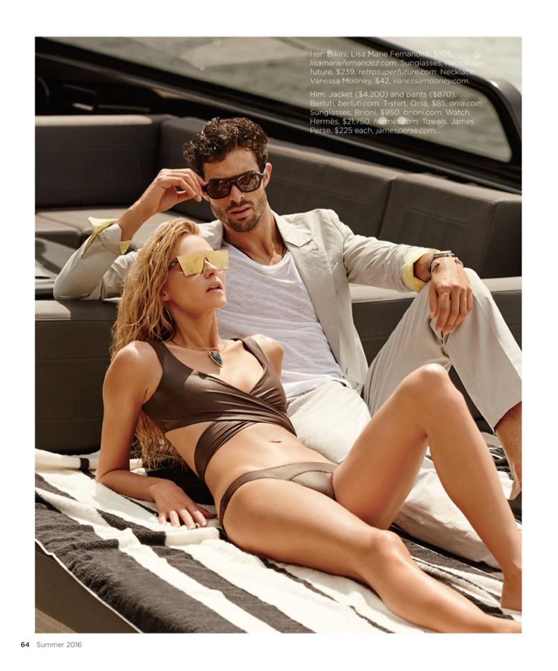 Valentina lounges next to Juan wearing Lisa Marie Fernandez bikini with Retrosuperfuture sunglasses