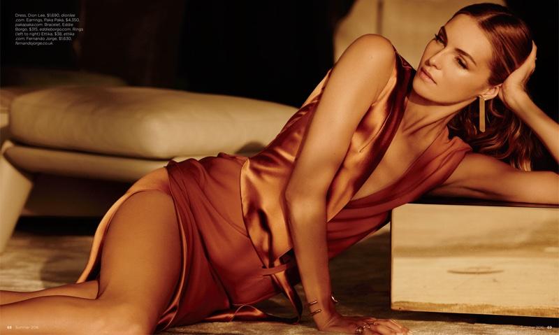 The blonde model flaunts her leg in Dion Lee dress