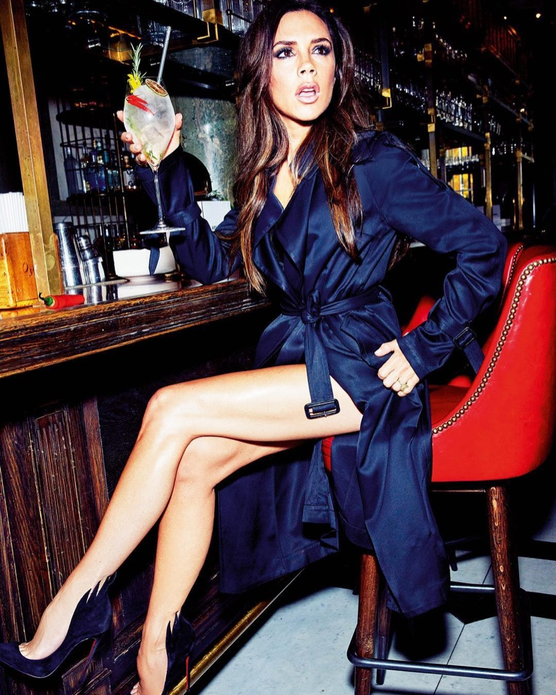 Victoria Beckham flaunts her legs in a trench coat